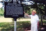 Stetson posing next to the Beluthahatchee marker