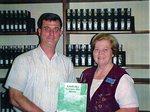 Tony Thompson Donates Book to Public Library
