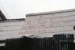 Red words on building side