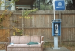 Couch next to payphone