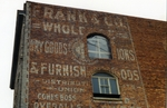 Faded words on brick