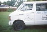 White van with cross on door