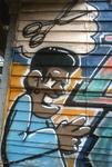 Graffiti of man and scissors