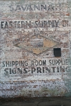 Faded sign on brick