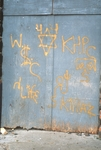 Graffiti on blue wall